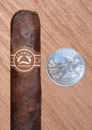 Padron 2000 Maduro with quarter for comparison